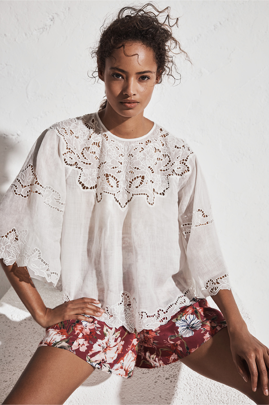 Woman wearing the Tia Embroidered Blouse and Rhea Short