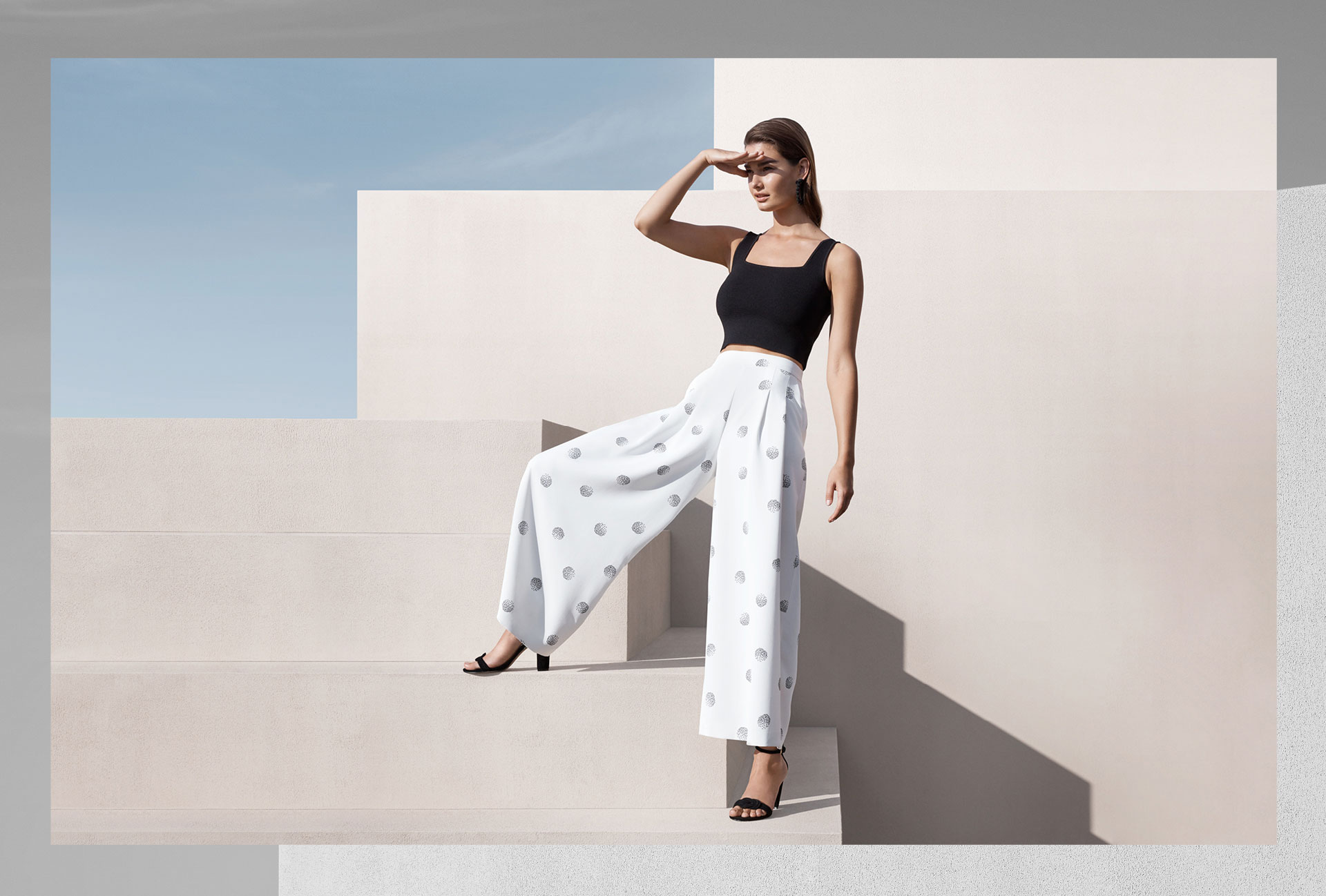 Woman wearing the Rosa Square Neck Knit Tank, Whinney Pant and Riley Heels