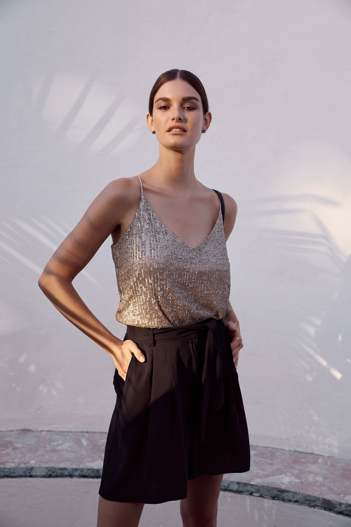 Woman wearing Sequin V Neck Camisole and Georgia Studs