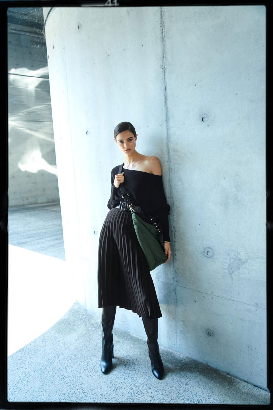 Woman wearing the Off Shoulder Knit, Pleated Belt Skirt, Porter Textured Belt, Lottie Nylon Tote and Delilah Bracelet