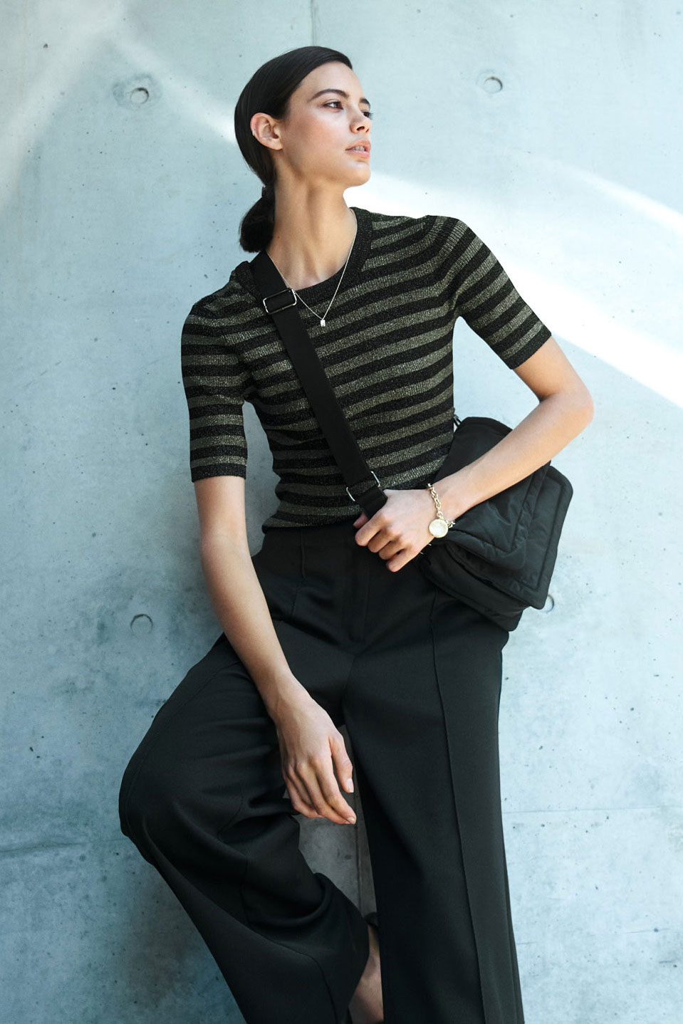 Woman wearing the Lurex Stripe Short Sleeve Knit, Wide Leg Pant, Mason Textured Loafer and Delilah Bracelet